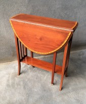 A Mahogany And Satinwood Oval Sutherland Table