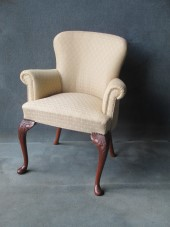 A Mahogany Cabriole leg Scroll Arm Chair