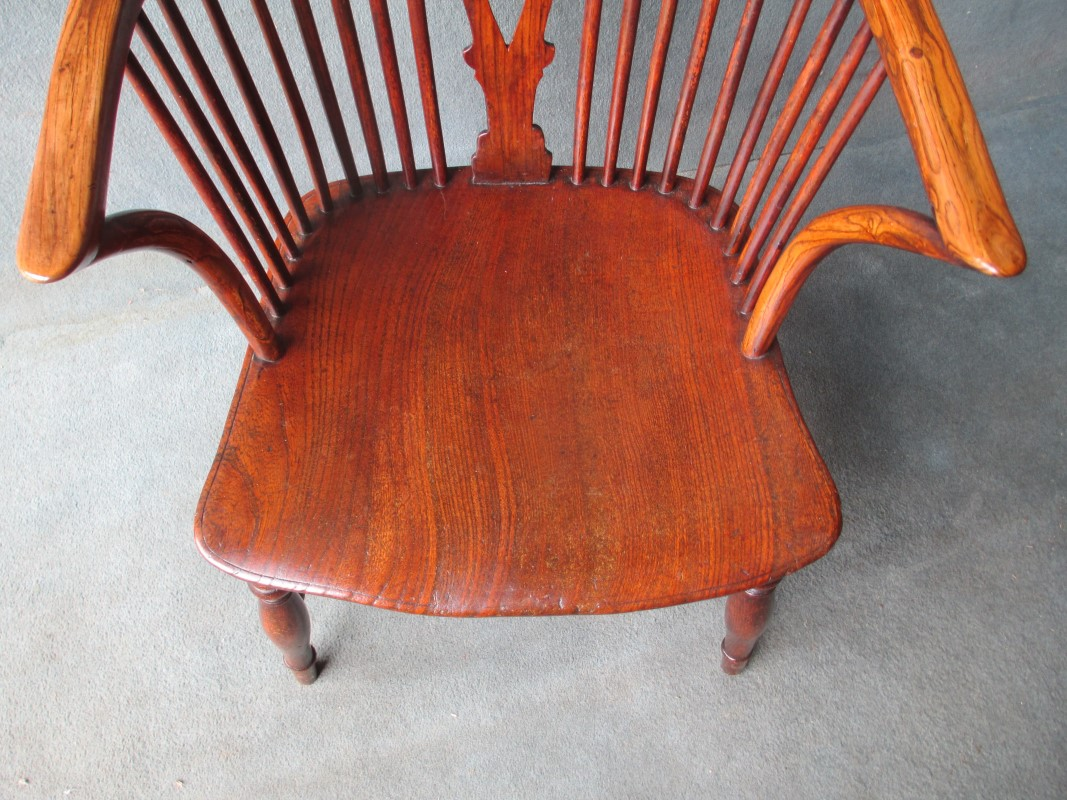 A High Back Stick and Wheelback Windsor Chair
